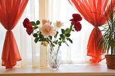 Bouquet of roses on window sill — Stok fotoğraf