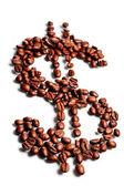 Kávová zrna v tvaru znak dolaru — Stock fotografie