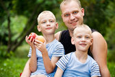 Happy dad with twin boys — Stock Photo