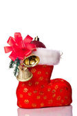 Red Santa's boot decorated with xmas ball and bells — Stock fotografie