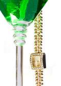 Wrist watch hanging from martini glass — Stock Photo