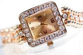 Golden wristwatch with gems — Stock Photo
