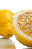Sliced lemon over white — Photo