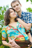 Beautiful young pregnant woman with husband — Stock Photo
