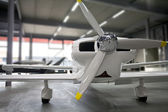 Airplane parked in hangar — Stock Photo