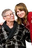 Mujer mirando anciano padre con amor — Foto de Stock