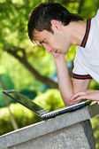 Man with laptop outdoor portrait — Stock Photo