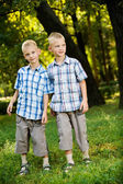 Two smiling twin brothers portrait — Stock Photo