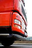 Moving red truck — Stock Photo