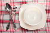 Empty plate, spoon and fork — Stock Photo
