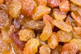 Dried yellow and brown raisins — Stock Photo