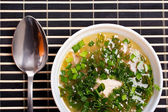 Soup with greenery — Stock Photo
