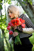 Blonde with red tulips — Stock Photo