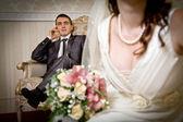 Beautiful bride and groom in indoor setting — Stock Photo