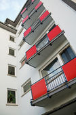 Building with red balconies — Stock Photo