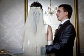 Bride and groom next to the mirror — Stock Photo