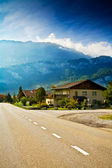Roadway running across small alpine village — Foto Stock