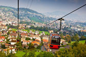 Cable railway and majestic cityscape revealing underneath — Stock Photo