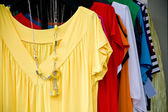 Display with summer clothes — Stock Photo