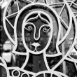Стоковое фото: Saint on metal church door