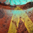 Yellow arrow on rusty metal surface — Stock Photo