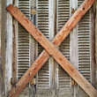 Stock Photo: Boarded up window shutter