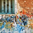 Stock Photo: Abandoned house wall with messy graffiti