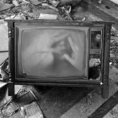 Ghostly figure on vintage tv set — Stock Photo