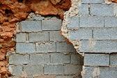 Broken stone and cinder block walls — Stock Photo