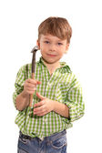 Child in the studio with a hammer — Stock Photo