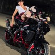 Stock Photo: Stripper with motorcycle