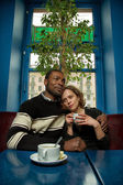 Interracial couple in cafe — Stock Photo
