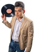 Vinyl record in the hands of a man in the style of Elvis Presley — Stock Photo