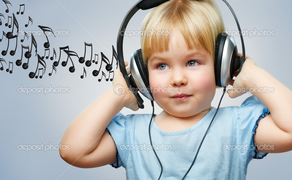A little girl listening to music — Stock Photo #8759225