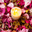 Candle with rose — Stock Photo