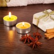 Candle, cinnamon and anise — Stock Photo