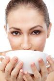 Woman drinking coffee — Stock Photo