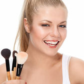 Beauty portrait with brushes — Stock Photo
