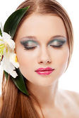 Beauty portrait with flower — Stock Photo