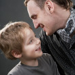 Father and son cheerfully talk. — Stock Photo