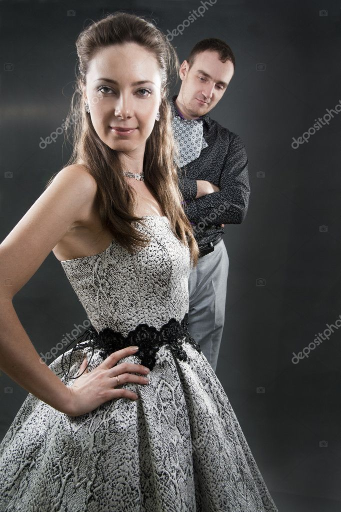 Relations of the loving Couples in Solemn Clothes on a black background.