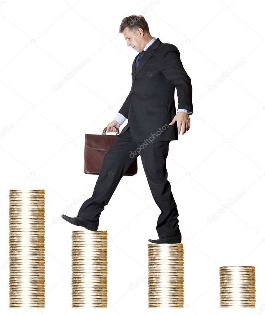 Businessman with briefcase walking money upstairs  — Stock Photo #8414002