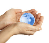 Hand holding the blue Earth — Stock Photo