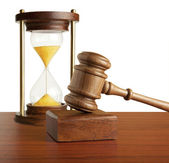 Hourglass and gavel — Stock Photo