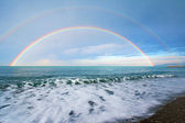 Double rainbow over sea — Stock Photo