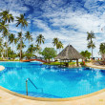 Swimming pool on the beach — Stock Photo