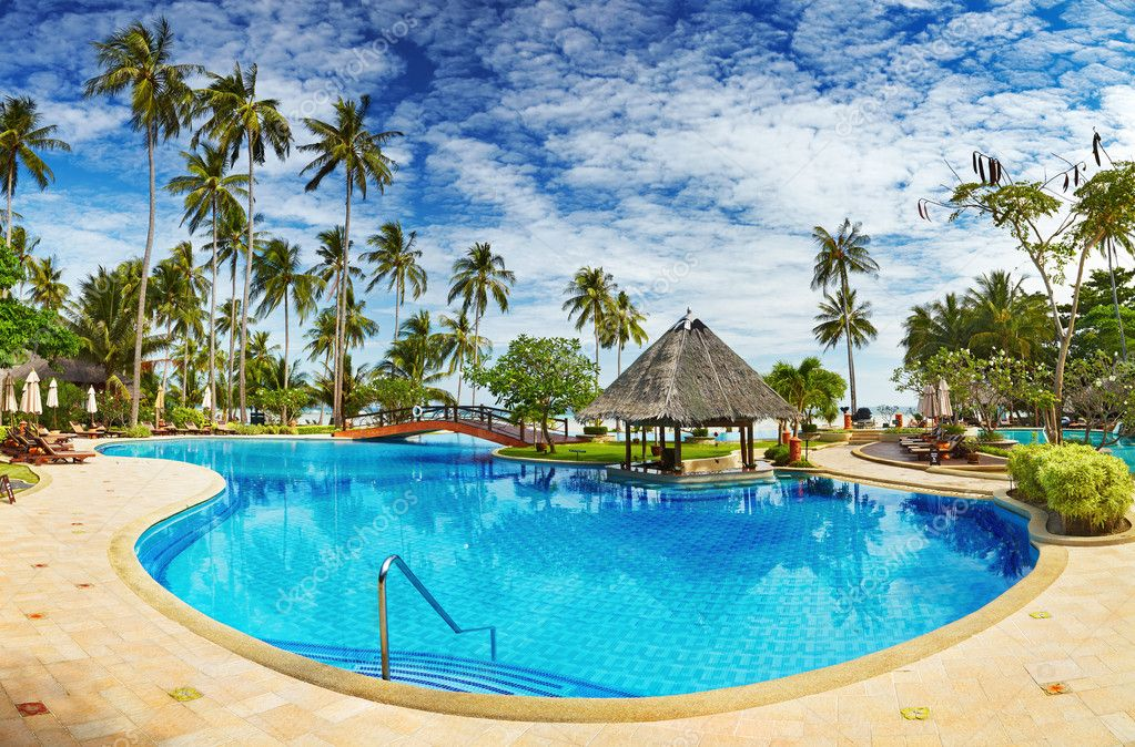 Recreation area with swimming pool on the tropical beach  Stock Photo #8914690