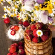 Strawberries and bouquet of  flowers — Foto de Stock