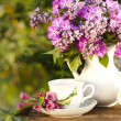 Porcelain cup with coffee and lilac — Stock Photo #8671352