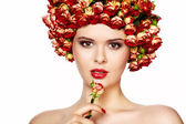Portrait of young beautiful woman with roses in hair, on white b — Stock Photo